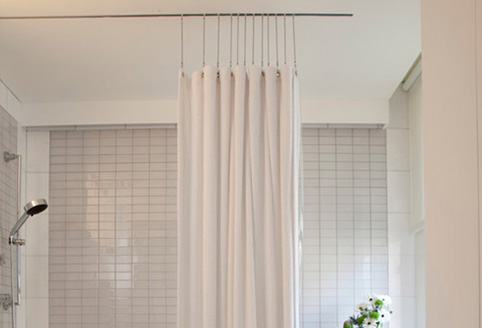 installation curved how shower to gettyimages a curvedshowercurtainrod install rod
